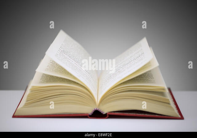 Close up of open book on counter - Stock Image