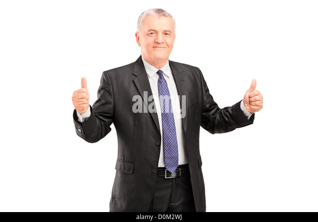 Happy mature businessperson standing and giving thumbs up isolated on white background - Stock Image