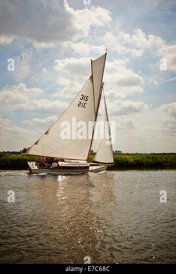 Classic Gaff Rigged Norfolk Broads River Cruiser Yacht With Topsail On The River Bure, Norfolk Broads, Norfolk, - Stock Image
