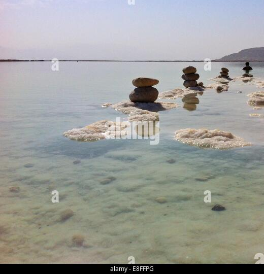 Stacks of pebbles in Dead Sea, Israel - Stock Image