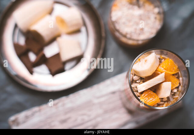 Smoothies and banana slices and biscuit on a tin plate horizontal - Stock Image
