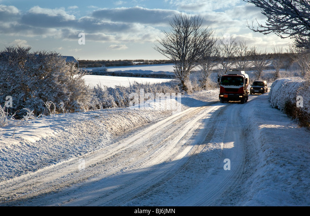 Vehicles on a snow covered road in North Yorkshire in the United Kingdom - Stock Image