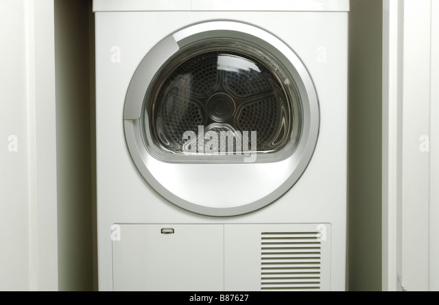 An empty laundry washing machine drying machine - Stock Image