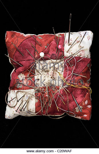needle cushion with various needles - Stock Image