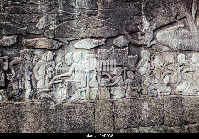 Cambodia, Bayon Temple, late 12th-13th. Century.  Bas-relief scene showing everyday life. - Stock-Bilder