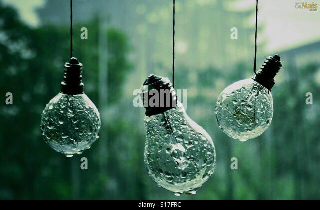 Wet  rained light bulbs - Stock-Bilder