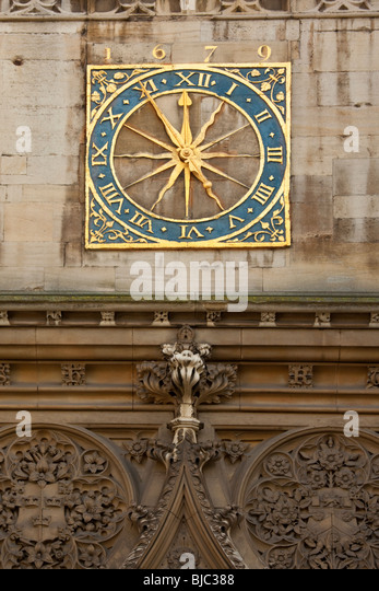 The old clock (1679) at St Johns College in the city of Cambridge in England - Stock Image