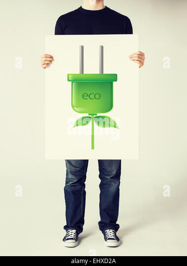 hands holding picture of green electrica ecol plug - Stock-Bilder