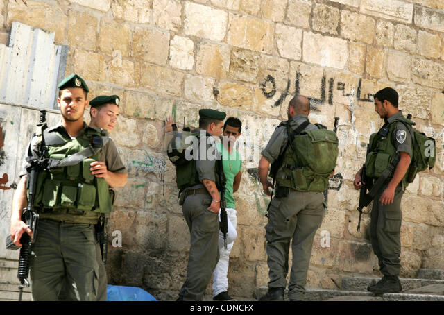 May 22, 2011 - Jerusalem, Israel - A Palestinian youth scuffles with Israeli border policemen in Jerusalem's - Stock Image
