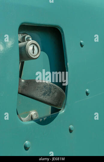 Close up of the driver side door handle of a Classic Series 2 Land Rover (specifically a Series 2a 109). - Stock Image