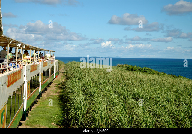 St Kitts Caribbean West Indies Sugar Train Scenic Railway cane fields and ocean - Stock Image