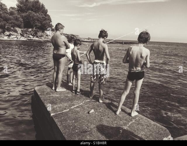 Five boys on the beach - Stock Image