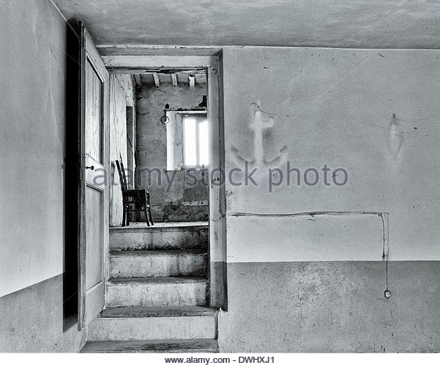 The 'dust shadow' of a ship's anchor on the wall in a deserted Nunnery, le Marche´, Italy, Europe. - Stock Image