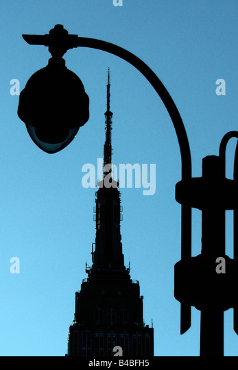 Graphic Scene of the Empire State Building in New York City USA It is Silhouetted Against a Blue Sky Copy Space - Stock Image