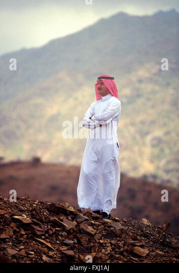 Exterior portrait of Arab man wearing traditional clothing; Asir Region; Kingdom of Saudi Arabia - Stock Image