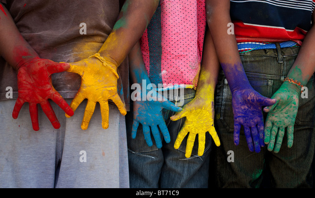 Indian boys multicoloured hands - Stock Image