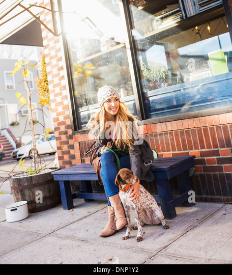 USA, New York City, Brooklyn, Williamsburg, Portrait of blond woman with dog - Stock Image