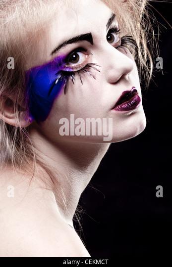 girls face with original make-up - fake eyelashes, sharpness on the second eye - Stock Image