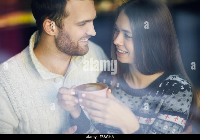 Romantic dates looking at one another - Stock-Bilder