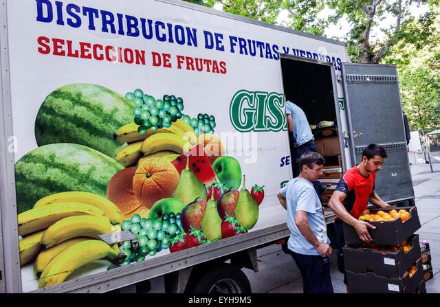 Madrid Spain Europe Spanish Recoletos Salamanca unloading wholesale food fruit distributor truck lorry Hispanic - Stock Image