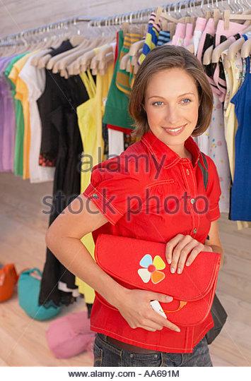 Woman shopping for handbag - Stock Image