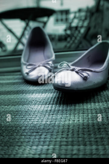 disgarded womens shoes - Stock Image