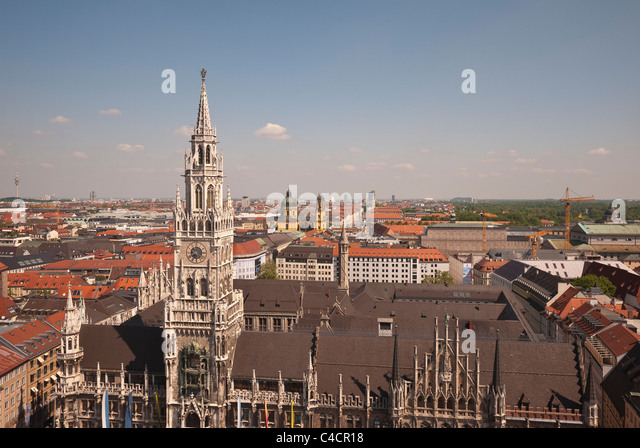 A view of the top of the New City Hall, Neues  Rathaus, with roof and towers of other buildings visible in Munich, - Stock Image