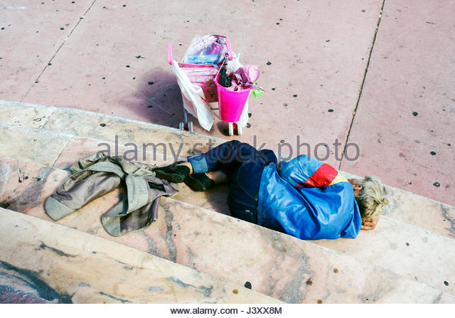 Miami Beach Florida Washington Avenue US Post Office marble steps woman senior homeless sleeping pink stroller poverty - Stock Image