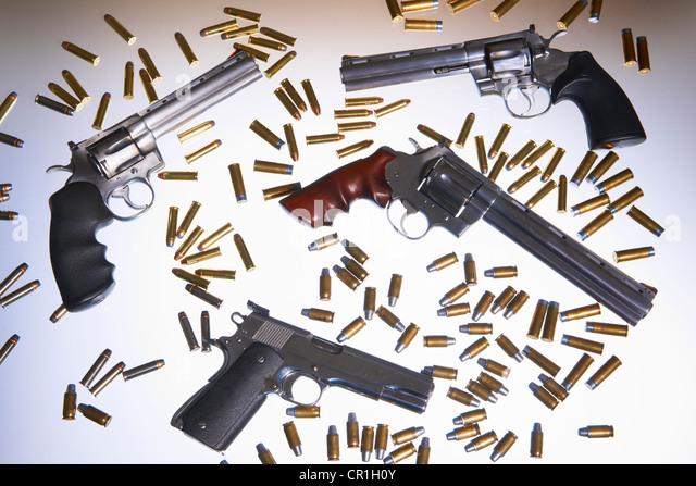 Various handguns and bullets - Stock Image