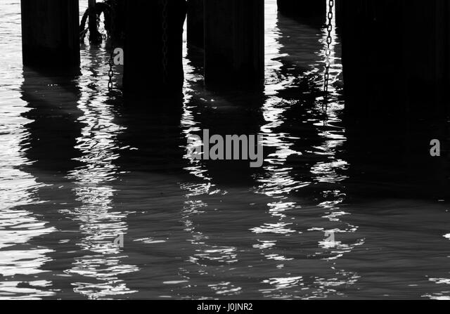 Abandoned pier at River Thames at Fulham Reach, Hammersmith, London, UK - Stock Image