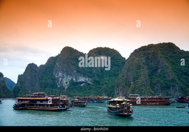Scenic views of limestone karsts and tourist boats in Ha Long Bay Vietnam - Stock-Bilder
