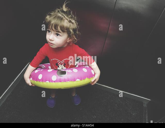 Toddler going to the swimming with inflatable ring - Stock-Bilder