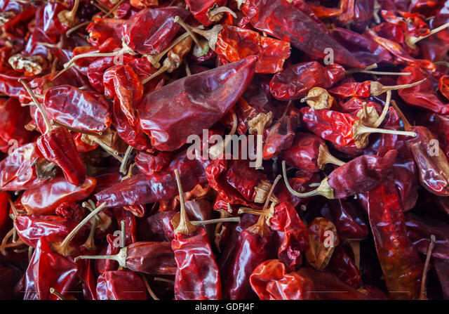 Dried red peppers (chili), closeup. - Stock Image
