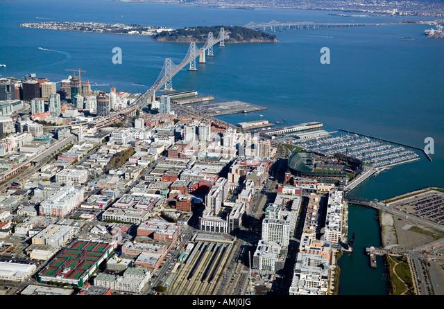 aerial above AT&T baseball park and CalTrain station in San Francisco with Bay Bridge and South Beach Marina - Stock Image