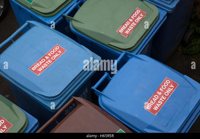 Bread and food waste bins outside a restaurant, ready for collection - Stock Image