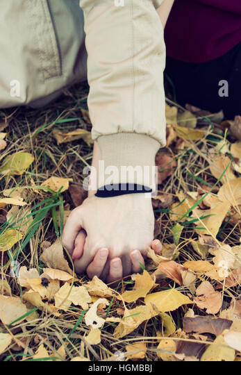 Young couple holding hands - Stock Image