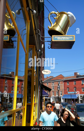 New Hampshire Portsmouth Market Street Portsmouth Brewery business sign Asian man woman couple - Stock Image