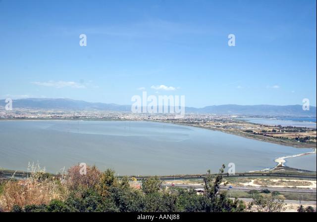 Cagliari Salt Flats, Sardinia, Europe, Cagliari sand salt flat salt pan shallow lagoon skyline landscape rural costal - Stock Image