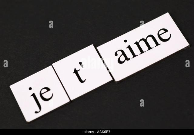 Magnetic fridge words spelling out Je t'aime - Stock-Bilder