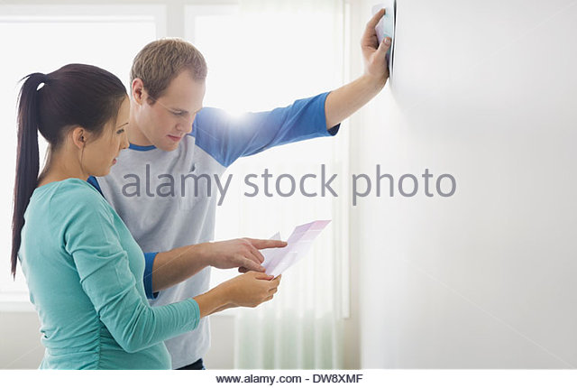 Couple looking at color swatches - Stock-Bilder