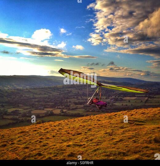 Hang glider taking off at Long Mynd in Shropshire UK. - Stock Image