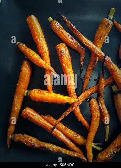 Fresh carrots simply roasted with salt and olive oil - Stock Image