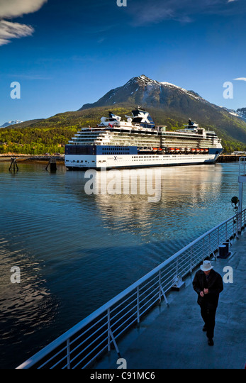 Alaska Marine Highway ferry moored next to a Celebrity Cruises cruise ship at the port of Skagway, Southeast Alaska, - Stock-Bilder