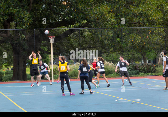 Melbourne Australia Victoria Flagstaff Gardens city park netball game basket man woman team teammates playing sport - Stock Image