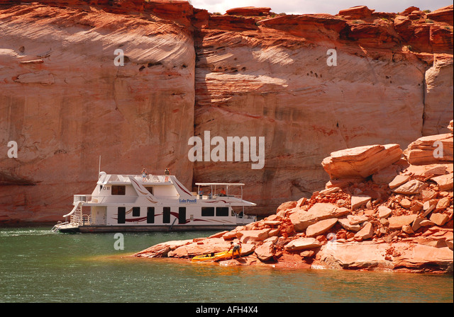 Arizona Lake Powell houseboat red canyon wall background outdoor recreation az - Stock Image