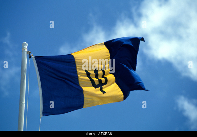 Barbados West Indies National Flag symbol Blowing in Breeze Blue Sky Caribbean - Stock Image