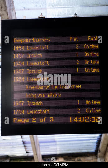 Railway departure board showing the 16:54 service to Lowestoft cancelled due to staff shortages, Saxmundham, Suffolk, - Stock Image