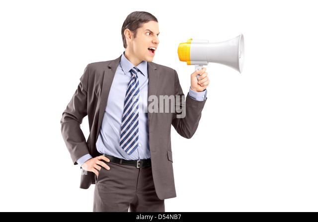 An angry young businessman announcing via megaphone isolated against white background - Stock Image