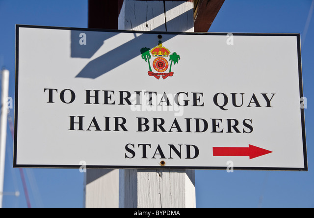 Antigua heritage quay hair braiders stand sign tourist shopping area - Stock Image