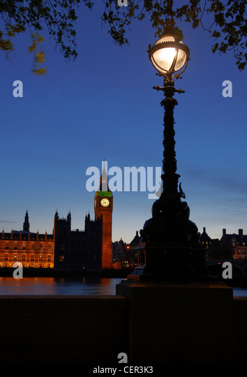 Houses of Parliament at night viewed from the South Bank. - Stock Image